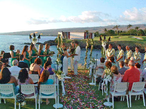 Members of Kona's Traveling Jewish Wedding Band perform for arriving guests as Gloria stands beneath the chuppah